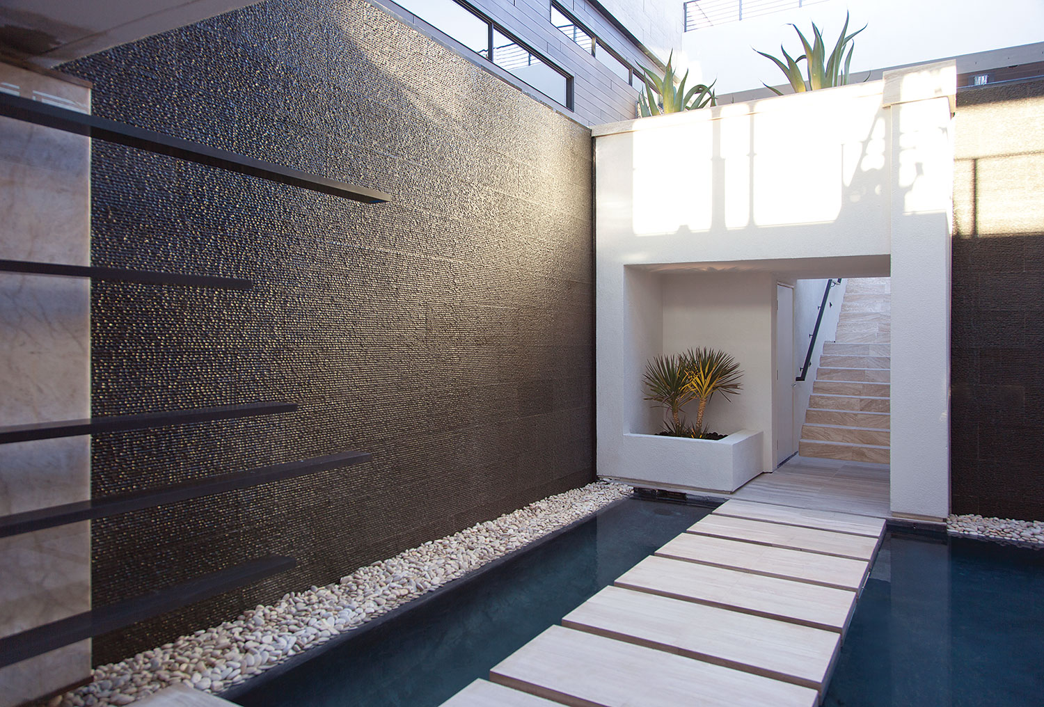 Water is everywhere at the new american home for Exterior wall designs